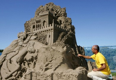 Italian sand sculptor, Leonardo Ugolini, puts the finishing touches to his four meter high creation: ' Spindle, Shuttle, Needle ' on the sea front at Weston-Super-Mare, Somerset.