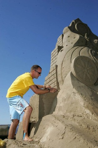 Sand sculptor, Maxim Gazendam, put the finishing touches to his four meter high creation: ' Cinderella ' on the sea front at Weston-Super-Mare, Somerset.